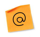 Adhesive note with at symbol Royalty Free Stock Photo
