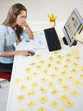 Adhesive notes. Tired business woman with adhesive notes on table. High angle view stock image