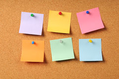 Adhesive Notes on Cork Surface Royalty Free Stock Image