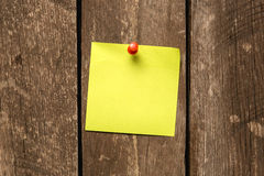 Adhesive notes pinning on wooden wall Royalty Free Stock Photo