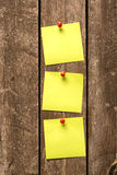 Adhesive notes pinning on wooden wall Stock Image