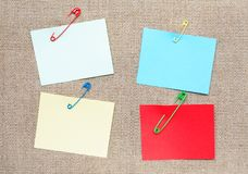 Adhesive Notes And Safety Pins Royalty Free Stock Images