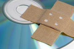 Adhesive plaster and CD ROM detail. Data rescue theme with band-aid and CD-ROM Stock Photo