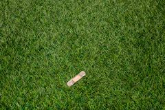 Adhesive plaster sticked to grass Royalty Free Stock Photo