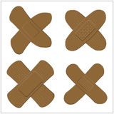Adhesive plaster - vector set. Flexible, fabric, medical bandage in different shape - curved cross. Illustration  on white Royalty Free Stock Image