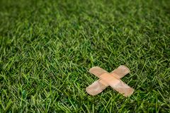 Adhesive plasters sticked to green grass close up Royalty Free Stock Image