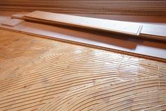 Adhesive primer spread, parquet laying in progress Stock Photo