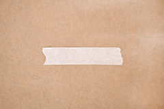Adhesive tape on brown paper Stock Photography