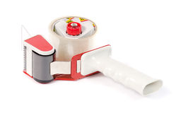 Adhesive tape holder with a red pen. Stock Image