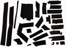 Adhesive tape pieces. Collection of black adhesive electrical tape pieces stock photo