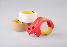 Adhesive tapes and holder dispenser isolated Royalty Free Stock Photo