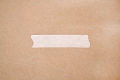 Adhezyjna taśma na brown papierze fotografia stock
