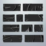 Adhezyjny lub maskujący taśma set Czarna gumowa izolowanie taśma z fałdami z rozdzierać krawędziami na tle fiksacja Fotografia Stock