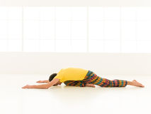 Adho Muka Kapotasana pose Stock Photo