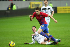 FC Steaua Bucharest- FC Gaz Metan Medias. Adi Popa fighting for the ball, during the football match, counting for the Romanian League One , between FC Steaua Stock Photos