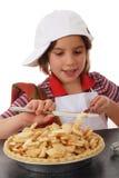 Adición de la mantequilla Foto de archivo