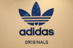 Adidas company logo. Adidas is German multinational corporation that designs and manufactures sports clothing and accessories Stock Images