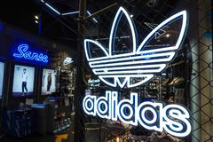 Adidas logo sports retail shop window front. Adidas fashion shop with logo and sign. Adidas sports retail store front in shopping mall China royalty free stock photography