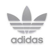 Adidas-Firmenzeichen Stockbild