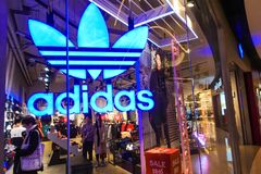 Adidas logo sports retail shop window front. Adidas fashion shop with logo and sign. Adidas sports retail store front in shopping mall China stock images