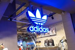 Adidas logo sports retail shop window front. Adidas fashion shop with logo and sign. Adidas sports retail store front in shopping mall China royalty free stock photo