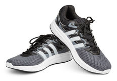 Adidas running shoes, sneakers or trainers isolated on white. MOSCOW, RUSSIA - APRIL 7, 2017: Pair of new gray Adidas sport running shoes, sneakers or trainers royalty free stock images