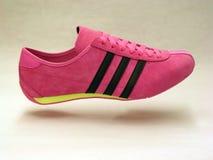 Adidas shoe. Pink magenta adidas shoe made of suede Royalty Free Stock Image