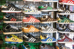 Adidas sneaker-shoes. Shoes at Sunday market in Bangkok, Thailand Stock Photo
