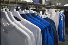 Adidas Sport Clothes on racks in a shop Stock Photos