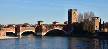 Adige River at sunset with Castelvecchio and Scaliger Bridge. Panorma of the Adige River in Verona with Castlevecchio and Scaliger Bridge Royalty Free Stock Image