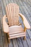 Adirondack chair. Kids Adirondack / Muskoka chair on wooden plank deck stock photography