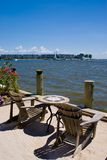 Adirondack Chair. Two Adirondack Chair  and table over looking the Chesapeake Bay in Maryland Royalty Free Stock Photos
