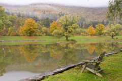 Adirondack Chair on Catskills Pond Royalty Free Stock Photo