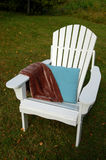 Adirondack chair outside. Adirondack chair with pillow and blanket Royalty Free Stock Photos