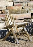 Adirondack Chair with Rock Wall Background stock image