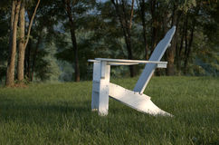 Adirondack chair in shade royalty free stock photo