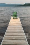 Adirondack chair on a wooden dock. Stock Photos