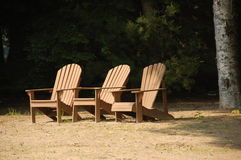 Adirondack Chairs. At a beach stock images