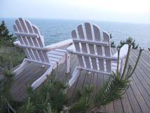 Adirondack Chairs. On deck Ocean View Royalty Free Stock Images