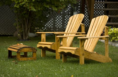 Adirondack chairs. A pair of Adirondack chairs in the yard.  Known as Muskoka chairs in Canada Stock Image