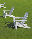 Adirondack Chairs. White Adirondack chairs on lawn Stock Images