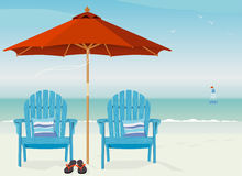 Adirondack Chairs at Beach. Relaxing scene on a breezy day at the beach Royalty Free Stock Photos