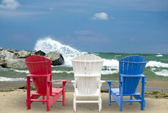 Adirondack chairs on beach Royalty Free Stock Photography