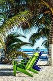 Adirondack chairs on Belize Beach stock image