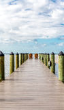 Adirondack Chairs at End of Pier Royalty Free Stock Photo