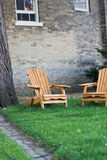 Adirondack chairs in front of old cottage Royalty Free Stock Photo