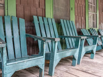 Adirondack chairs. Inviting Adirondack chairs in front of an old mountain lodge Stock Image