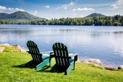 Adirondack chairs. Mirror Lake, Lake Placid New York. Summer, vacation, outdoors, travel, explore, nature, camping, lake and mountain vacation concept Royalty Free Stock Photos