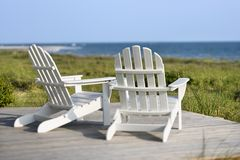 Adirondack chairs overlooking beach. Stock Photo