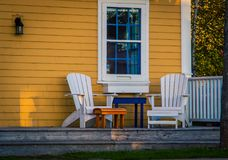 Front porch and chairs. Adirondack chairs on a porch in nova scotia canada Stock Photos